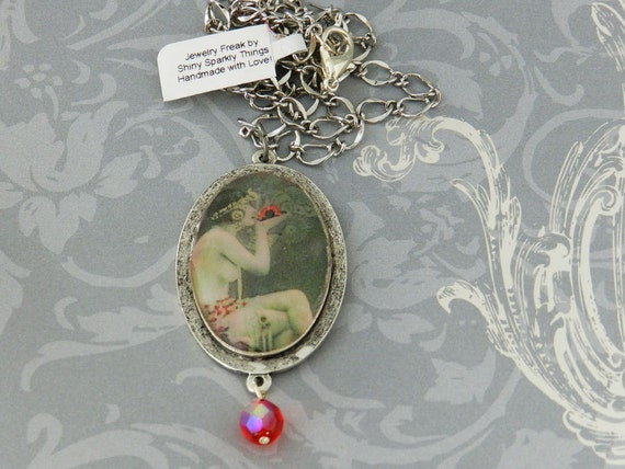 Vintage Burlesque Dancer Oval Cameo Resin Pendant in Silver-tone Mounting with a faceted glass drop-bead JF1002
