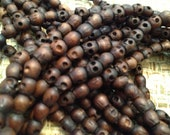 Carved Wood Skull beads - 5x6 mm strand of 75