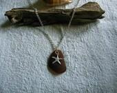 Brown beach glass necklace with starfish. Sea glass jewelry.