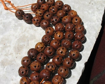Lu-tong wood beads by the strand