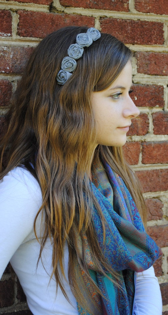 Silver metal headband with 5 small gray rosettes. fits women and children.