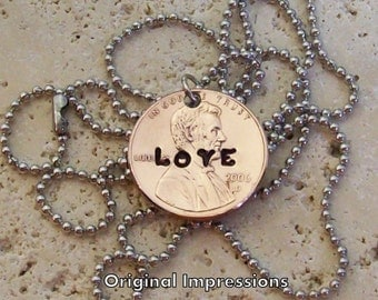 Love penny coin pendant necklace made of a genuine U.S. penny coin on a stainless steel chain.