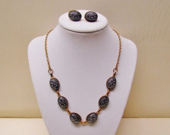 Vintage necklace and earrings with embossed black glass cabochons, 1960's costume necklace and clip earrings