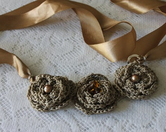Vintage Three Gold Crochet Flowers on Ribbon with Gold Fasteners.