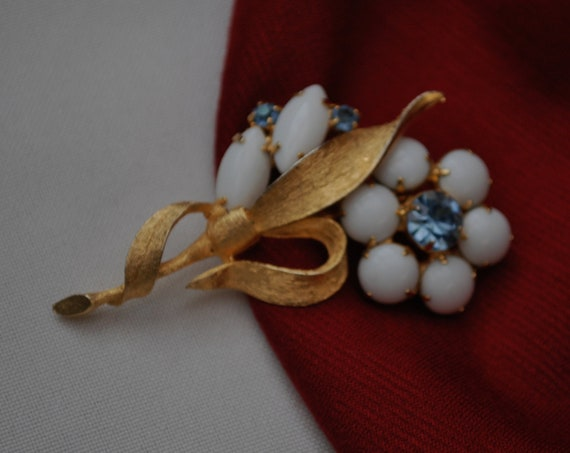 Vintage milk glass blue rhinestone flower brooch
