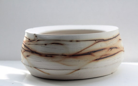 Handthrown ceramic container with copper oxide