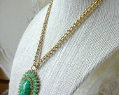 green with envy signed celebrity necklace
