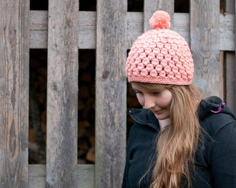 Crocheted chunky hat beanie with a pom pom crocheted in warm wool in apricot peach orange
