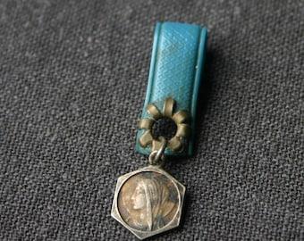 Little blue pendant. Vintage religious charm.