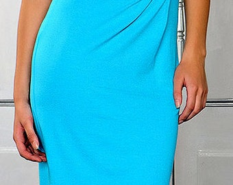 turquoise sleeveless dress. The skirt to the knee.