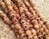 Carved Bone Skull beads - 9x10 mm strand of 45