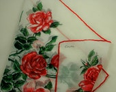 Vintage Colette hankie, white cotton with print of large red roses, green leaves and stems