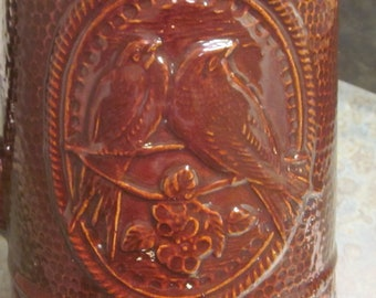 A E Hull Salt Glaze Brown Pottery Pitcher with Birds 1905