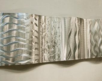 Silver Handmade Modern Sculpture - Reflective Abstract Metal Art - Home Decor - Metallic Hanging Wave Accent - Magnitude Wave by Jon Allen