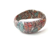 Decoupaged Paper Leaf Jewelry, chunky, colorful geometric bangle bracelet / orange, red, leaves, wavy shape, pictures, collage bracelet