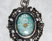 Mustard Seed Frame Necklace with Blue Background