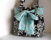 Lage Diaper Bag Made of Black and White Damask  Fabric and Large Aqua Bow