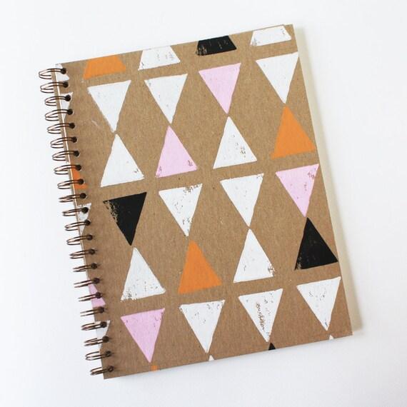 triangle notebook no. 1 ... white, pink, orange, and black on kraft