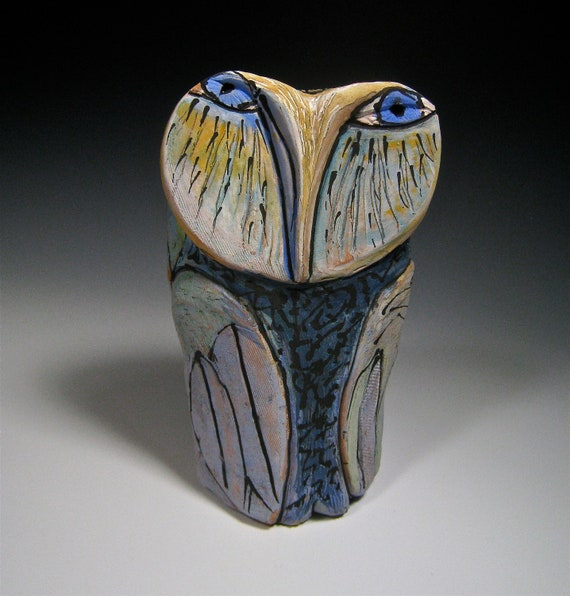 Ceramic owls, owl sculpture, art. Owl Person Standing in the Rainbow in the Field of Grass