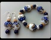 Blue white beige beaded lampwork bracelet matching pierced earrings