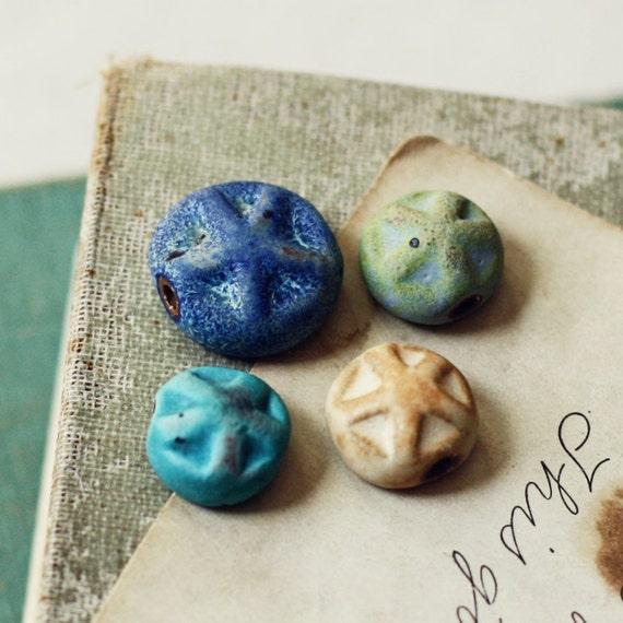 Starfishes- handmade ceramic bead set