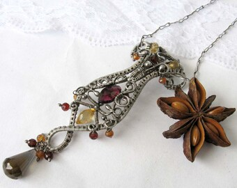 Viungo- Sterlig silver pendant necklace with garnet, hessonite whiskey quartz and citrine