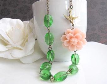 Large Peach Flower. Nature Garden Inspired. Flying swallow. Lovely bloom flower blossom with green twisted glass beads Flower necklace