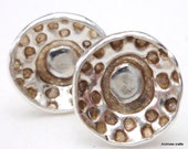 Silver stud earrings, retro seed head design.