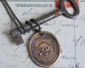 skull and crossbones wax seal necklace in bronze... memento mori - suegrayjewelry
