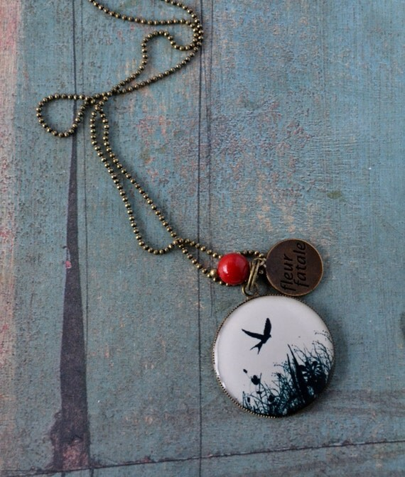 Lonely Bird -  medaillon necklace in antiqued brass with lipstick red coral stone