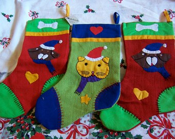 three burlap christmas stockings