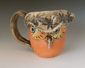 Porcelain Owl Mug in Autumn colors is Hand thrown with Orange glaze and Blue Eyes