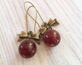 Carnelian with Antiqued Bow Drop Earrings in Brass