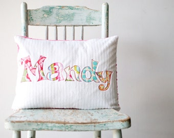 A Monogrammed Pillow for the Home and Nursery in MIRAGE, Personalized with Your Baby or Toddler Girl's First Name in Fuchsias