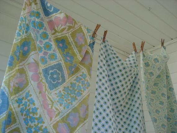 Three vintage floral pillowcases