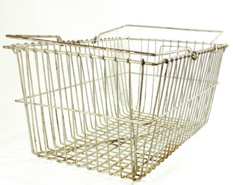 industrial metal basket . old shopping basket or egg and harvest basket . lovely shabby chic . 1950s 1960s farm or bicycle style