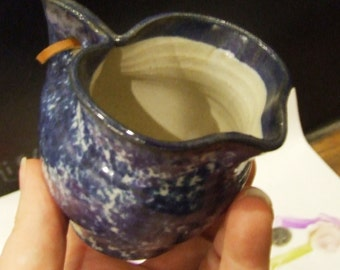 Cute Little Hand Thrown and Pinched Blue and White Glazed Pitcher Signed by the artist with a leather cordon handle