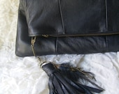 Buttery soft leather fold-over clutch with removable leather and feather tassel