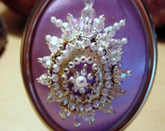 Victorian Like Vintage Style Oval Framed Pearl Sequin Art  Mounted to a Pearlized Shimmery Lavender Satin Fabric.