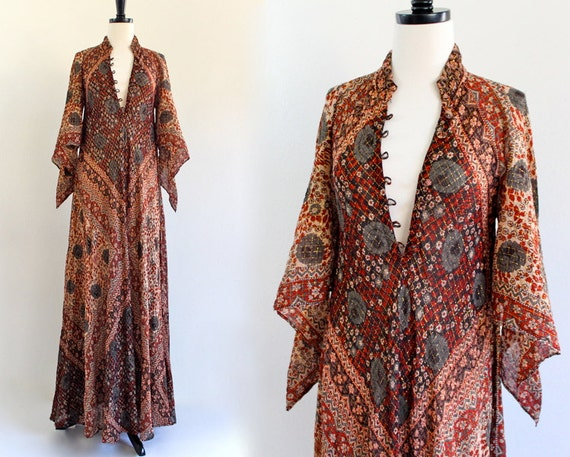 printed 70s maxi dress with plunging neckline and winged sleeves