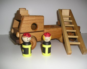 Wood fire truck with Handpainted fire fighters and a handrubbed beeswax finish