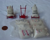 Sale item, 3 miniature dollys and 8 sacks of food stuffs
