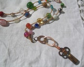 Gypsy Gewels colorful hand knotted beaded necklace with vintage brass patina skeleton key