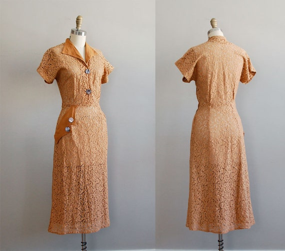 spice colored vintage dress from the 40s with detail on neckline and hip