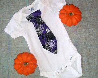 Halloween baby outfit with tie, spider webs and skulls. Dress up party, baby costume party for kids, daycare. October Halloween baby.