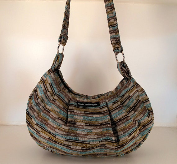 "SALE. HALF OFF. Hobo in ""Lines"" fabric. Heavy grey background with green and blue. Strong texture. Made in San Francisco."