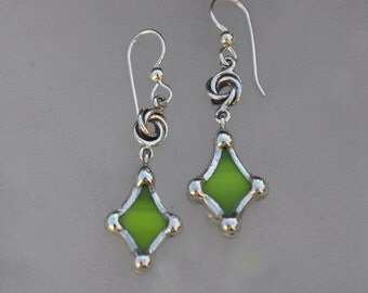 Avacado green curved diamond earrings