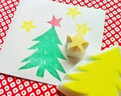 christmas tree rubber stamps. cedar tree and star hand carved rubber stamp. christmas scrapbooking. gift wrapping. holiday crafts. set of 2