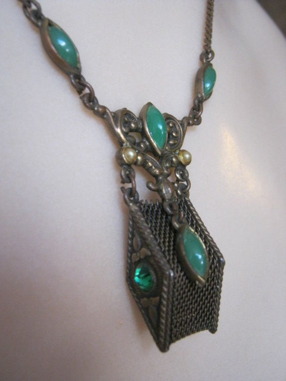 Cool old necklace with basketweave pendant and green stones and crystals