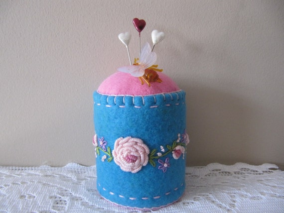 Pincushion with hand embroidery
